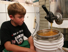 watching the honey flow into the sieve